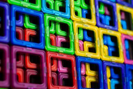 Foto de Pattern of colored squares of the magnetic constructor; geometric figures - Imagen libre de derechos