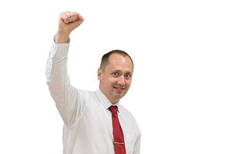 Foto de Portrait of happy young man in shirt and red necktie celebrating, gesturing, keeping arms raised and expressing positivity. Isolated on white. young handsome excited man with hands up. - Imagen libre de derechos