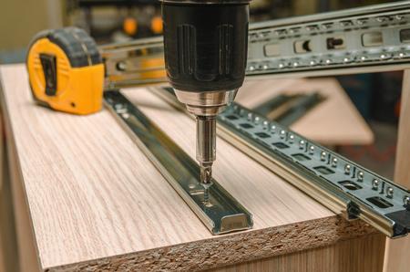 Photo pour Assembling of furniture closeup - image libre de droit