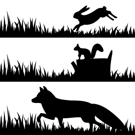 Illustration pour Vector set silhouettes of animals in the grass  - image libre de droit