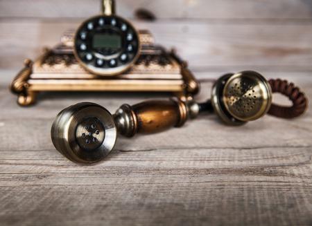 Photo pour Vintage Telephone on an Old Wood Table - image libre de droit