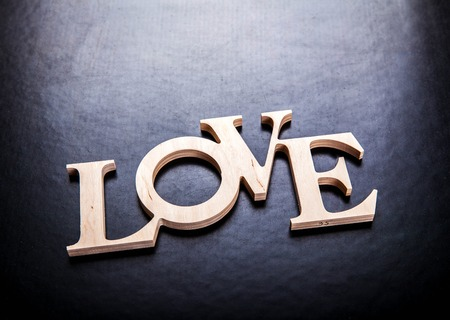 Photo for text love on black background - Royalty Free Image