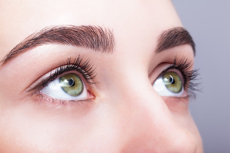 Photo pour Closeup shot of female green pistachio colour eye  with day makeup - image libre de droit