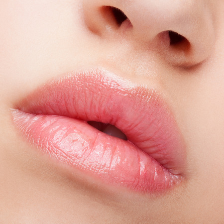 Photo pour Close-up beauty shot of female full lips with healthy skin and rose color lips - image libre de droit
