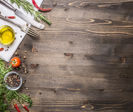Foto de ingredients for cooking vegetarian food, tomatoes, butter, herbs, colorful peppers on wooden rustic background top view border, place for text - Imagen libre de derechos