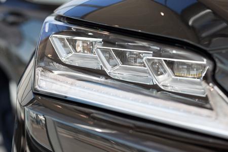 Photo pour New modern vehicle with elegant head lamps. Front view. Modern transportation. - image libre de droit