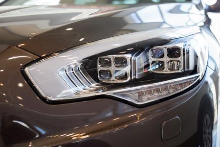 Photo pour New modern car with elegant quadrate head lamps. Front view. Close up. - image libre de droit