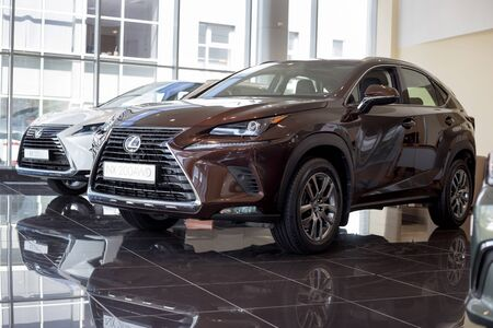 Photo pour Russia, Izhevsk - July 21, 2019: New modern cars NX 200AWD and RX350L in the Lexus showroom. Famous world brand. Prestigious vehicles. - image libre de droit