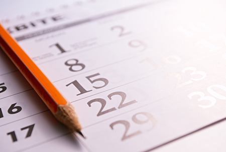 Photo pour Close-up of a sharp pencil on the page of a calendar, in order to mark days with events - image libre de droit