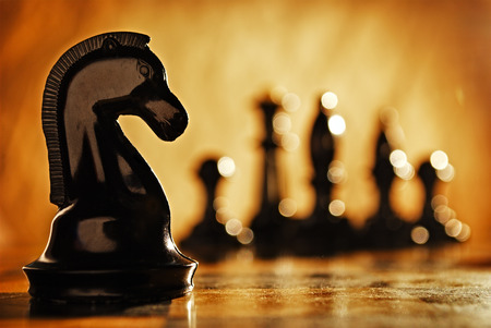 Photo pour Chess knight chess pieces in front and in the background. The idea of winning and strategies. - image libre de droit