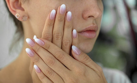 Photo for Beautiful womans nails with beautiful french manicure ombre - Royalty Free Image