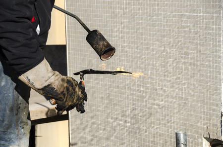 Photo for laying of waterproofing sheathing and insulation during the renovation of a roof in Italy - Royalty Free Image