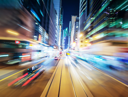 Photo pour Abstract urban background of night city blurred by motion - image libre de droit