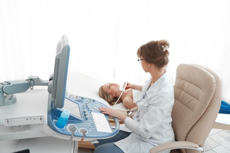 Foto de Young woman getting breast ultrasound scanning - Imagen libre de derechos