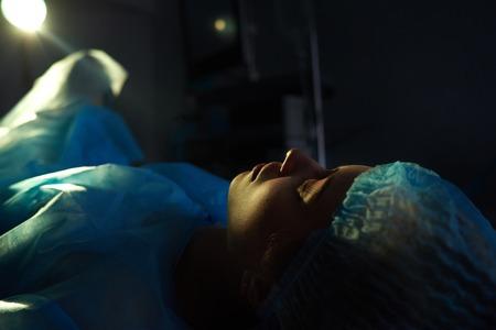 Foto de Female patient undergoing surgery - Imagen libre de derechos