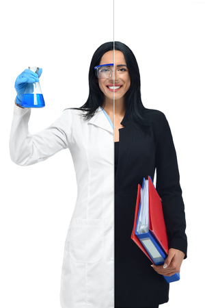 Foto de Successful girl in two occupations of scientist and businesswoman isolated on white background. Scientist in white coat holding tube with blue liquid and accountant with document folders in hand. - Imagen libre de derechos