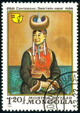 Foto de Ukraine - circa 2018: A postage stamp printed in Mongolia show Expectant Mother. Artist's Painting Sengniesohio. Series: International Decade for Women. Circa 1981. - Imagen libre de derechos
