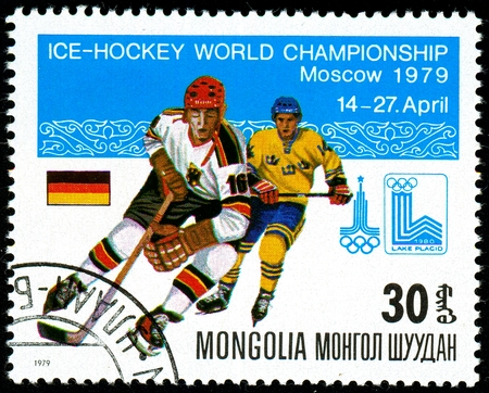Foto de Ukraine - circa 2018: A postage stamp printed in Mongolia show hockey. A players in the uniform of Germany and Sweden. Flag Germany. Series: Moscow ice hockey world championships. Circa 1979. - Imagen libre de derechos