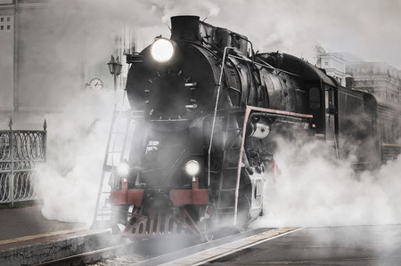 Photo for Retro steam train departs from the railway station  - Royalty Free Image