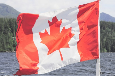 Photo for Canada flag on the Vancouver island nature background. - Royalty Free Image