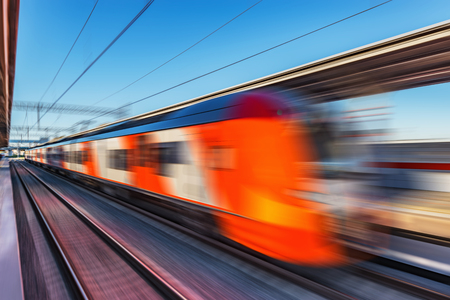 Foto per Modern high-speed train moves fast along the platform. Blurred image. - Immagine Royalty Free