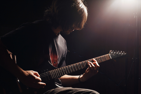 Photo for young guitarist play on the electric guitar - Royalty Free Image