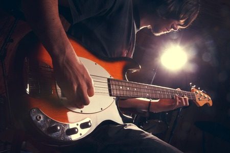 Photo for guy playing bass, guitar close-гз - Royalty Free Image