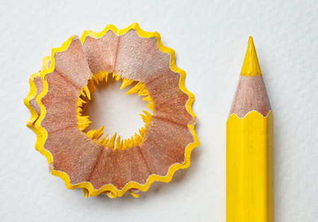 Photo pour yellow pencil and shavings on white background - image libre de droit