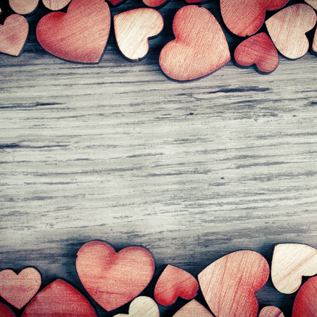 Photo pour background with wooden  hearts, place for text - image libre de droit