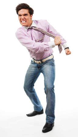 Angry man tear his tie man wearing jeans, shirt and tie, isolated on white