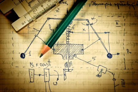 Photo pour pencil and a slide rule on the old page with the calculations in mechanics - image libre de droit