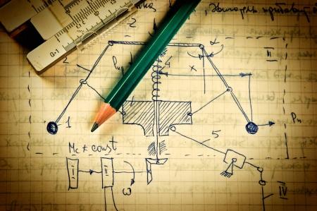 Foto de pencil and a slide rule on the old page with the calculations in mechanics - Imagen libre de derechos