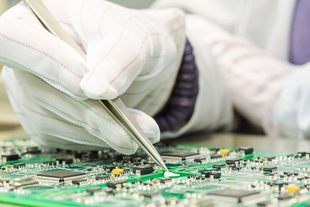 Photo pour Engineering and electronic component quality control in QC lab on computer PCB turnkey manufacturing  - image libre de droit