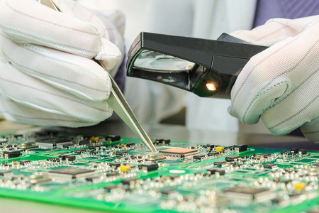 Foto de Quality control of electronic components on PCB in laboratory high-tech factory - Imagen libre de derechos
