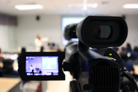 Foto de Photographer recording  video lecturer and student learning in classroom of university. - Education or seminar concept blur image use for background. - Imagen libre de derechos
