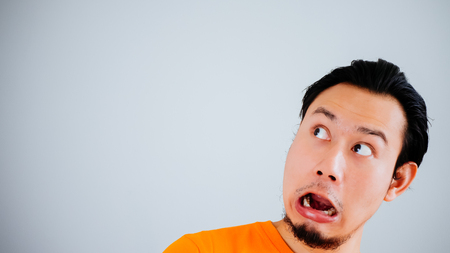 Photo for Shocked and surprised face of Asian man with Velvia filter. - Royalty Free Image