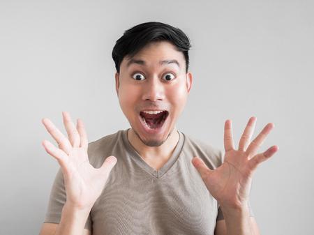Foto de Asian man feels shock and surprise with overly face expression. - Imagen libre de derechos