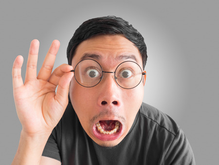 Photo pour Shocked and surprised funny face of Asian man with eyeglasses and beard. - image libre de droit
