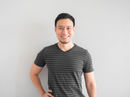 Photo for Smile and confident Asian man in black shirt. - Royalty Free Image