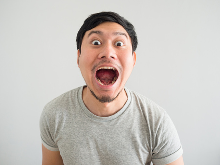 Foto de Funny face of bad breath Asian man. - Imagen libre de derechos