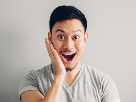 Photo for Headshot photo of Asian man with happy face. on grey background. - Royalty Free Image