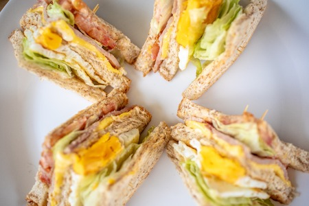 Photo for Closeup of breakfast set of club sandwiches. - Royalty Free Image