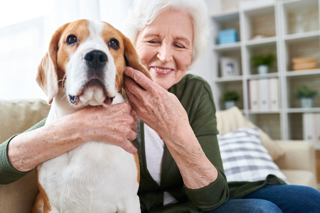 Photo for Happy Senior Woman Hugging Dog - Royalty Free Image