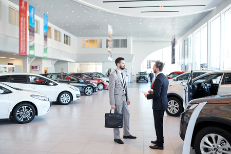 Photo for Car Salesman Consulting Client - Royalty Free Image