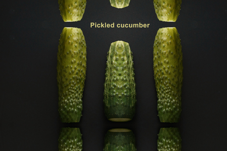 Photo for pickled cucumber. lots of cucumbers on a black background. salting, home-made for the winter - Royalty Free Image