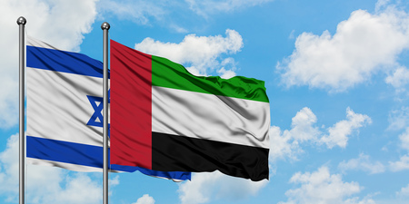 Photo pour Israel and United Arab Emirates flag waving in the wind against white cloudy blue sky together. Diplomacy concept, international relations. - image libre de droit