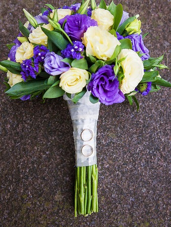 Photo for bridal bouquet of purple and beige colors and wedding rings - Royalty Free Image