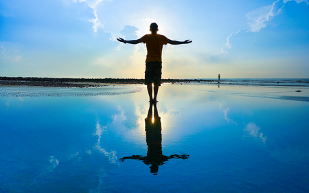 Photo for Silhouette of Man Raising His Hands or Open arms when sun rising up - Royalty Free Image