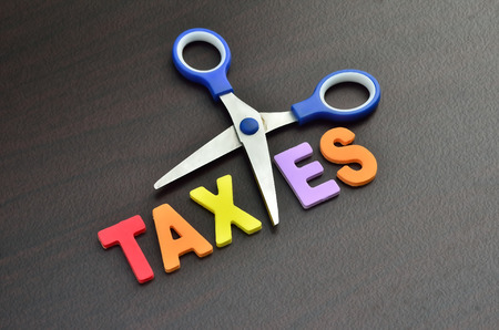 Foto de scissors and the alphabet TAXES - Imagen libre de derechos