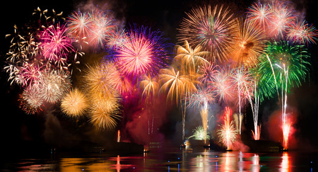 Photo pour Colorful fireworks. Fireworks are a class of explosive pyrotechnic devices used for aesthetic and entertainment purposes. Visible noise due to low light, soft focus, shallow DOF, slight motion blur - image libre de droit